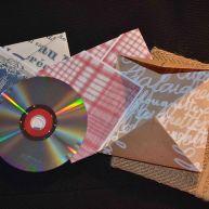 CD, joli papier de couleur et sac étui en toile de jute